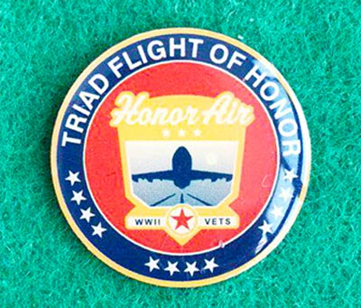 A Challenge Coin is small two sided coin or medallion that bears a