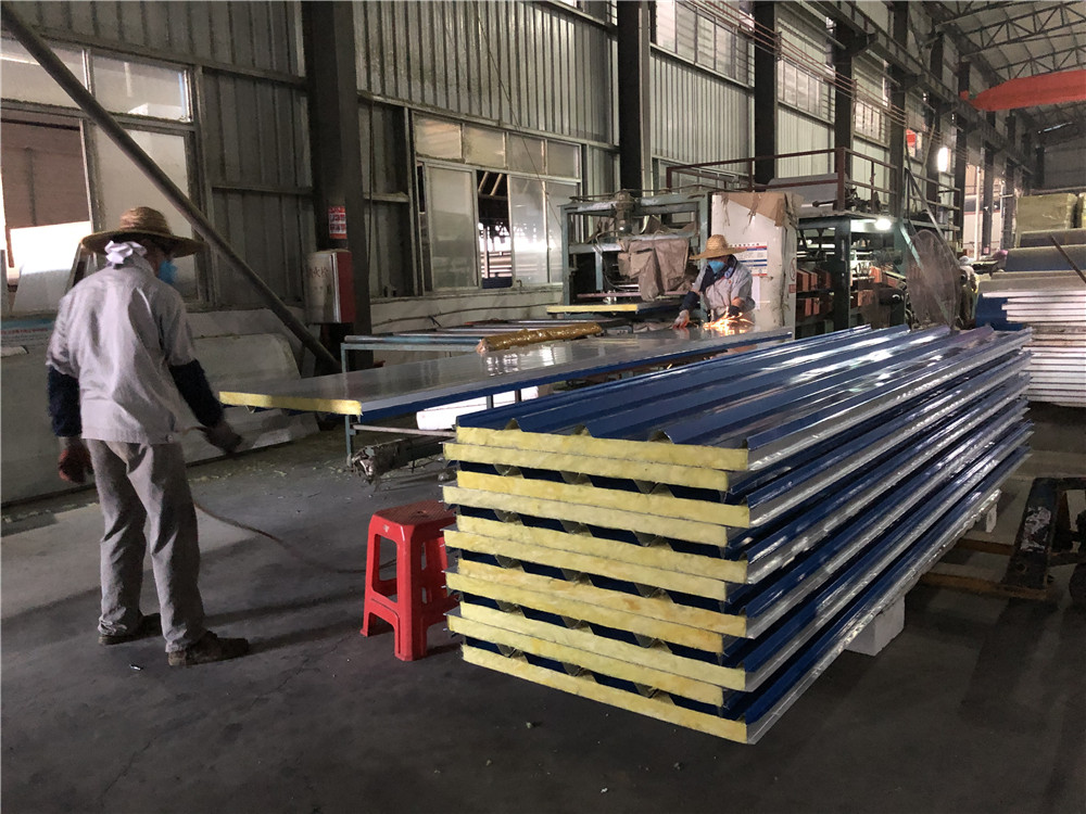 Glass wool sandwich roof panels production at factory
