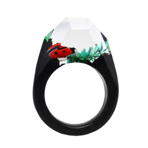 Wholesale wood ring,New wood ring with metal ladybug inside suppliers