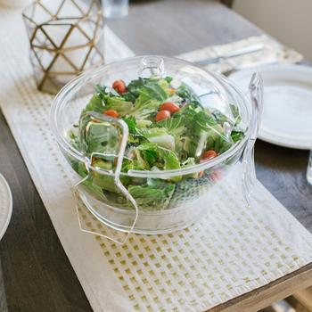 Chilled salad bowl on ice with spoon and fork  itemprop=