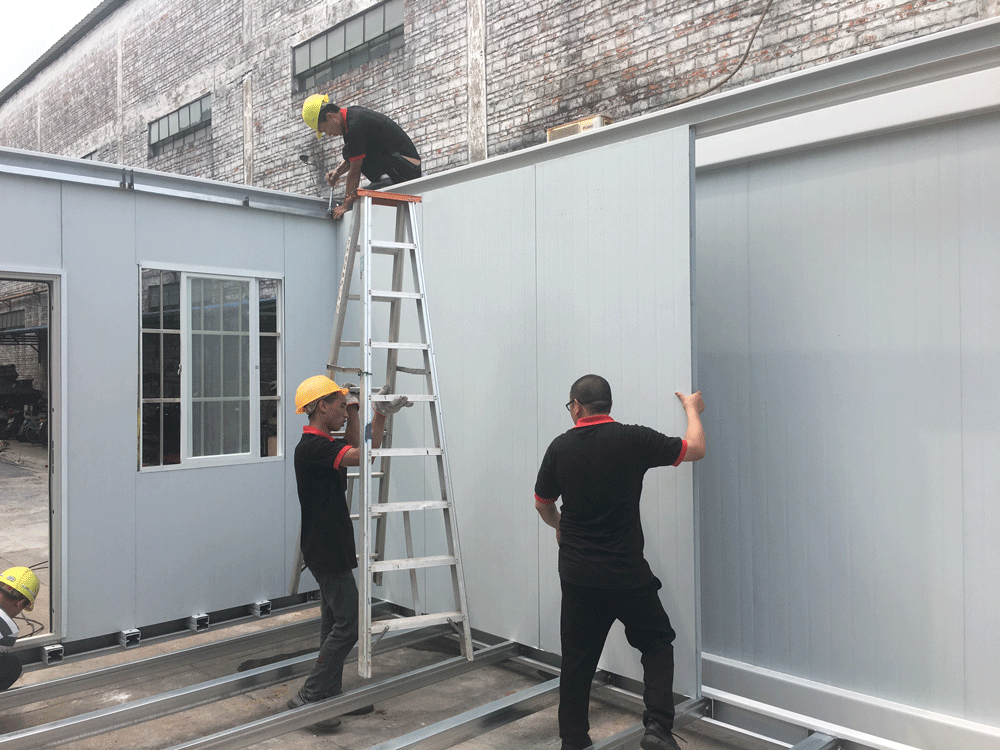 Color steel sandwich panels were installing on the worksite.