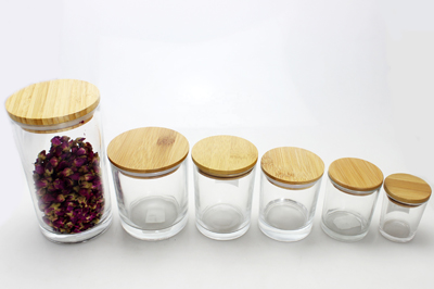 glass candle candy jar with wooden lids in storage bottle