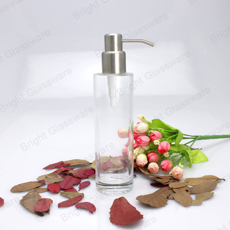 transparent refillable essential oil glass bottle for shampoo with rustproof rubbed sainless steel pump