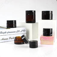 Factory cheap price stocked 5ml 10ml 20ml 25ml 30ml 85ml amber glass cosmetic jars with black plastic cap wholesale