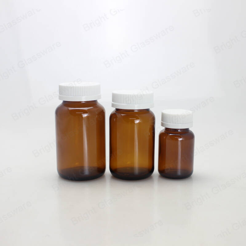 wide mouth empty pharmacy bottles amber pharmaceutical medical glass bottle with white plastic screw lids