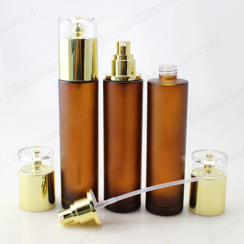 luxury 100ml amber glass lotion bottles serum cosmetic pump bottle with golden cap