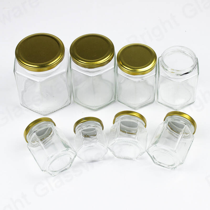 China supplier cheap hexagon glass honey jar with screw lid