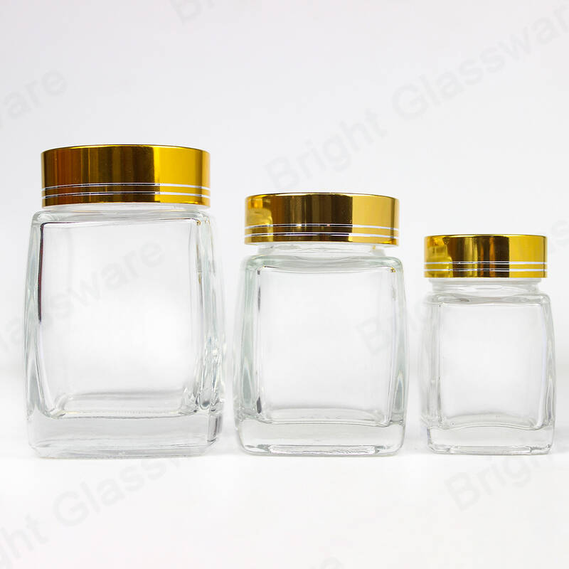 50ml 100ml 200ml square shape spice glass jar empty honey jars wholesale with gold/silver cap