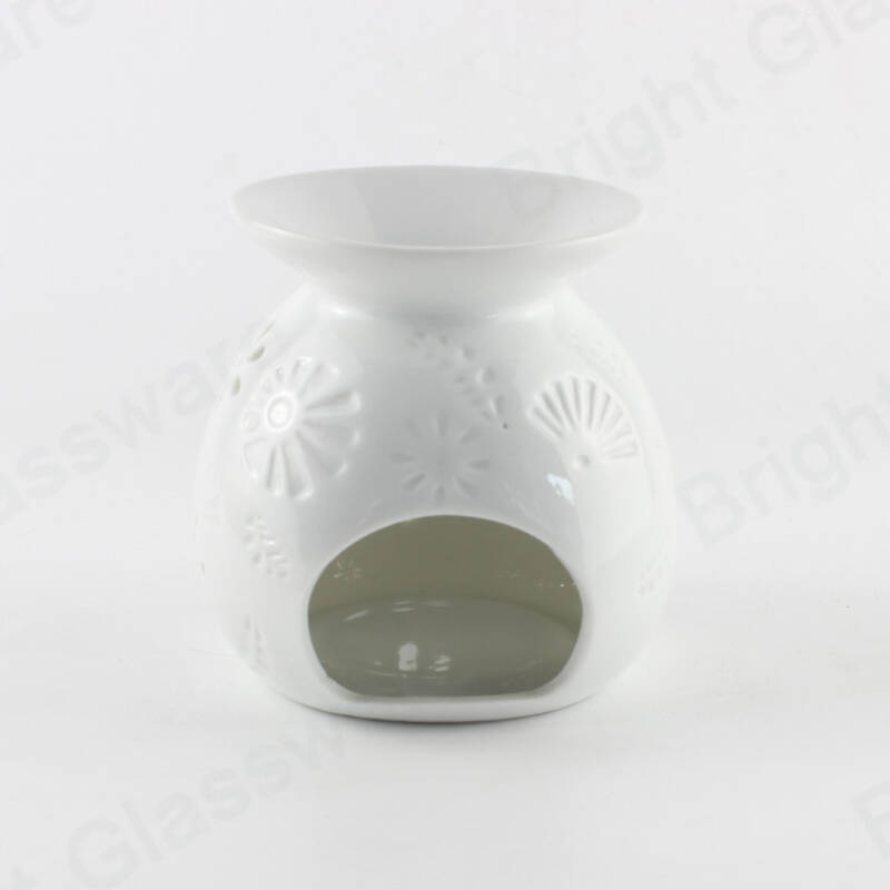 modern hollow out flower design white ceramic oil burner for aromatherapy wholesale