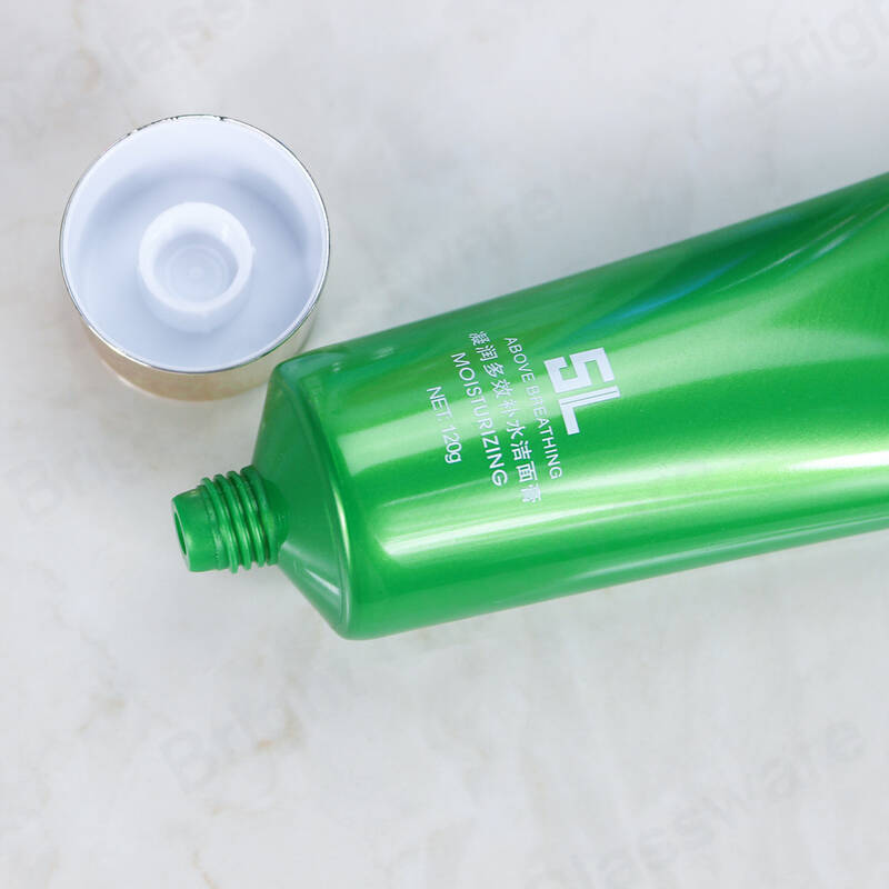 empty 120g green face wash cosmetic tube packaging with gold cap