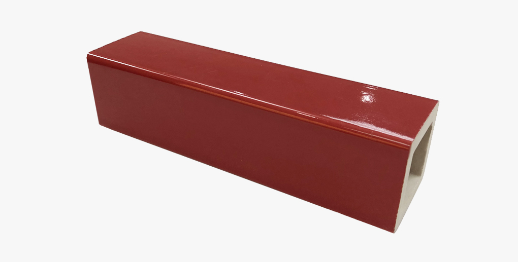 Glazed red decorative baguette terracotta facade