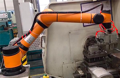 Robot arm for CNC lathe