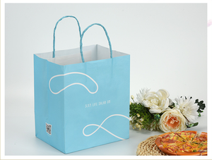 white kraft paper carry bag with twisted handle